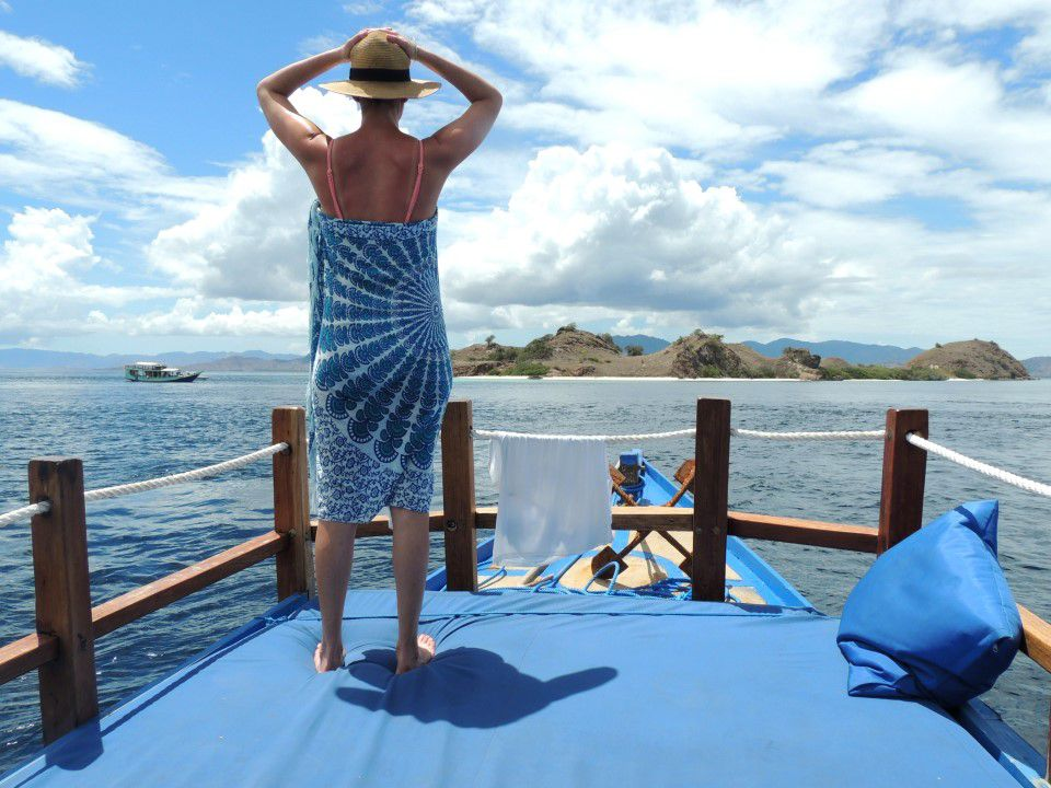 The Kindness of Strangers | Boatman Wearing Blue | Travel Blog komodo islands